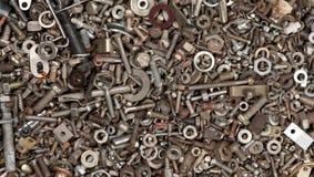Tuercas de acero - y - fondo de los tornillos Fotos de archivo libres de regalías