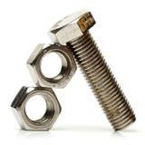 Tuercas de acero - y - tornillos Imagen de archivo libre de regalías