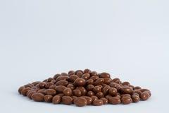 Tuercas en chocolate Fotos de archivo libres de regalías