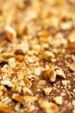 Tuercas en el caramelo del chocolate Foto de archivo libre de regalías