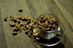 Tuercas en una taza Imagen de archivo libre de regalías
