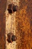 Tuercas oxidadas Fotos de archivo libres de regalías
