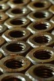 Tuercas oxidadas Imágenes de archivo libres de regalías