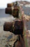 Tuercas oxidadas - y - tornillos Foto de archivo libre de regalías