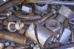 Tuercas y desecho grandes de los tornillos Imagen de archivo