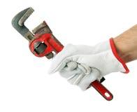 Llave a disposición con el guante del trabajo Foto de archivo libre de regalías