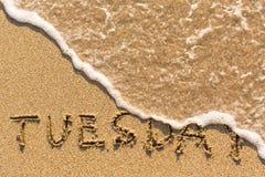 Tuesday - drawn of the hand on the beach sand Stock Photos