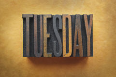 Tuesday. The word TUESDAY written in vintage letterpress type royalty free stock photo