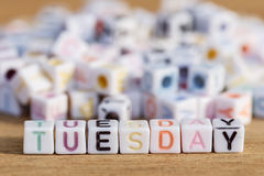 Tuesday written in letter beads on wood background Stock Photo