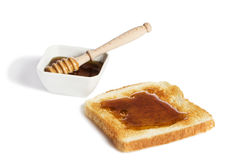 Tueste con la miel un tarro de la miel con un dippe de la miel Fotografía de archivo