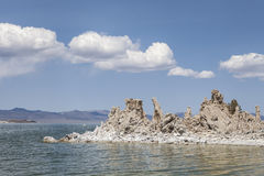 Tufa Towers in Mono Lake. Mono Lake in California's high desert with tufa towers and puffy clouds Royalty Free Stock Photos