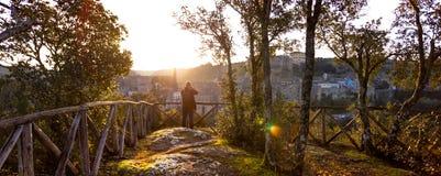 Tuff city of Sorano. Man making a photo shoot of old city sorano at dawn, italy royalty free stock images