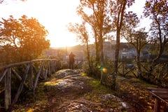 Tuff city of Sorano. Manl making a photo shoot of old city sorano at dawn, italy Stock Photography