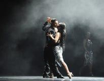 Tuff grabb-identitet för panelljus av dentango dansdramat Arkivfoto