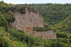 Tuff rock near Sorano, Maremma, Tuscany, Italy. Lanscape with cave carved in the tuff rock near Sorano, Maremma, Tuscany, Italy Stock Photo