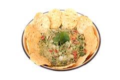 Tuffo del Guacamole con i nachos Fotografia Stock