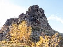 Tuffstone formation in Dimmuborgir. Who reminiscent of an ancient collapsed citadel. Therefore, in Icelandic mythology it is seen as a homestead by elves and Stock Images