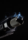 Tuft of smoke. Small amount of smoke coming from the barrel of an rifle Stock Image