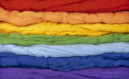Tufts of wool of different colors parallel to each other form a rainbow. Conceptual photo.  stock images
