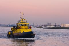 Tug. Passing by at sunset on the river Royalty Free Stock Photography