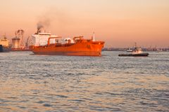 Tug And Tanker Sailing Out Royalty Free Stock Photos