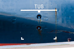 Tug area sign on ship hull. Royalty Free Stock Photo