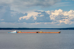 Tug and barge on the big river. Volga landscape Royalty Free Stock Photos