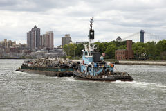 Tug and barge of scrap metal Royalty Free Stock Photos