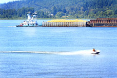 Tug, Barge and Jet Ski Traffic Stock Photo
