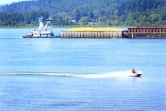 Tug, Barge and Jet Ski Traffic stock photo