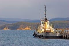Tug Boat. A tug boat alongside the pier in Two Fold Bay New south Wales Australia Stock Photo