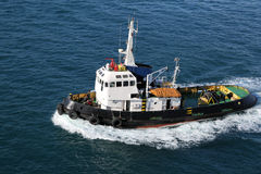 Tug Boat. A tug boat pulling into position in the harbor Royalty Free Stock Photo
