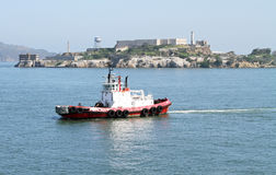 Tug Boat by the Alcatraz Island in San Francisco, California Stock Photo