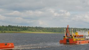Tug boat with barge. On the river stock video