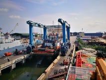 Tug boat berthing at shipyard Stock Photo