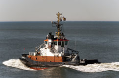Tug boat Bugsier 21 in the entrance channel to Esbjerg, Denmark. Stock Photos