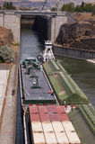 Tug boat and cargo barge. Exits the lock at The Dalles dam on the Columbia River in Washington state, USA Stock Photos