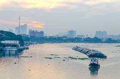 Tug Boat cargo ship in Chao Phraya river in evening. Royalty Free Stock Image