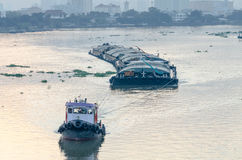 Tug Boat cargo ship in Chao Phraya river in evening. Stock Images
