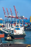 Tug boat and cargo ship Royalty Free Stock Images