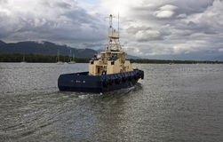 Tug boat coming into harbor Stock Images