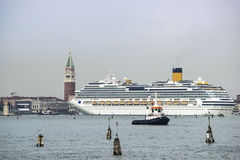 Tug boat and cruise liner in front of Doges palace in summer Ven Royalty Free Stock Images