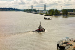 A tug-boat cruising along vancouver's  waterfront Royalty Free Stock Photography
