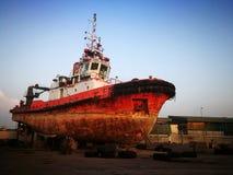 Tug boat at docked Stock Photo