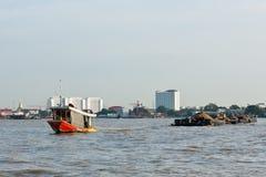 Tug boat drag  sand barge Stock Photos