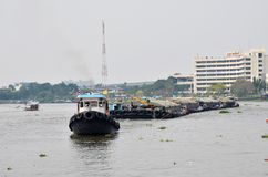 Tug boat drags sand barge on Chao Phraya river Stock Image