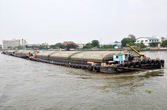 Tug boat drags sand barge on Chao Phraya river Stock Photo