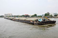 Tug boat drags sand barge on Chao Phraya river, Bangkok Royalty Free Stock Images