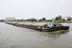 Tug boat drags sand barge on Chao Phraya river, Bangkok Royalty Free Stock Images