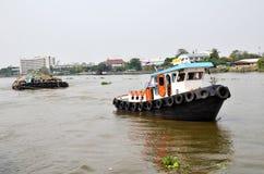 Tug boat drags sand barge on Chao Phraya river, Bangkok Royalty Free Stock Image